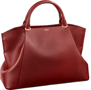 C de Cartier bag, medium model Red spinel taurillon leather, golden finish
