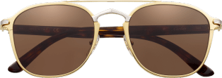 C de Cartier Sunglasses Combined golden and black, matte golden-finish frame, smooth palladium-finish bridge, brown lenses.