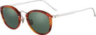 C de Cartier Sunglasses Combined titanium and light tortoiseshell-effect composite, palladium finish, green polarized lenses.