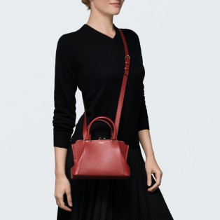 C de Cartier bag, mini model Red spinel-colored taurillon leather, golden finish