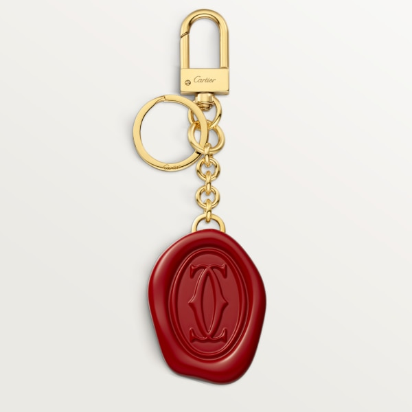 Diabolo de Cartier key ring with wax seal motif Lacquered gold-finish metal