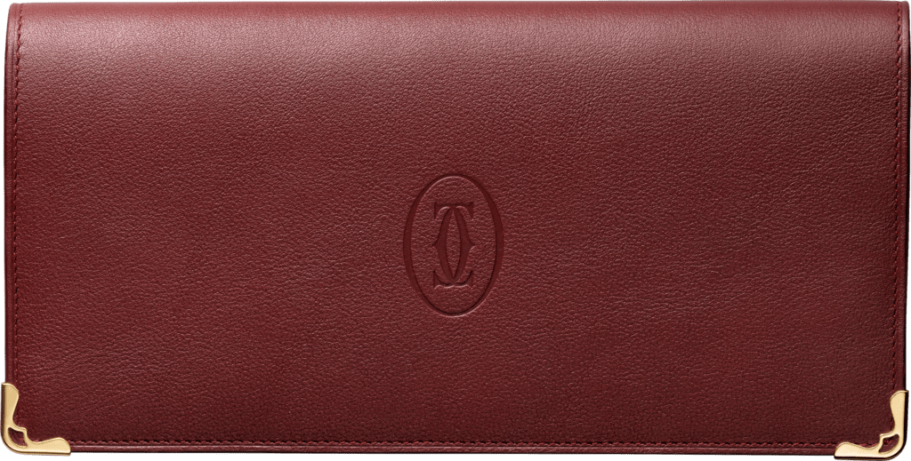 Must de Cartier Small Leather Goods, zipped international walletBurgundy calfskin, golden finish
